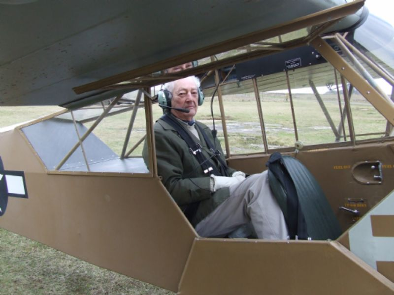 Tim in back seat of spotter plane
