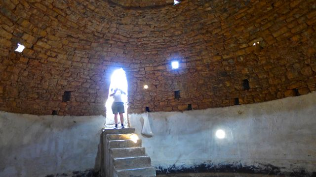 Lost in blaze of light on threshold of cistern