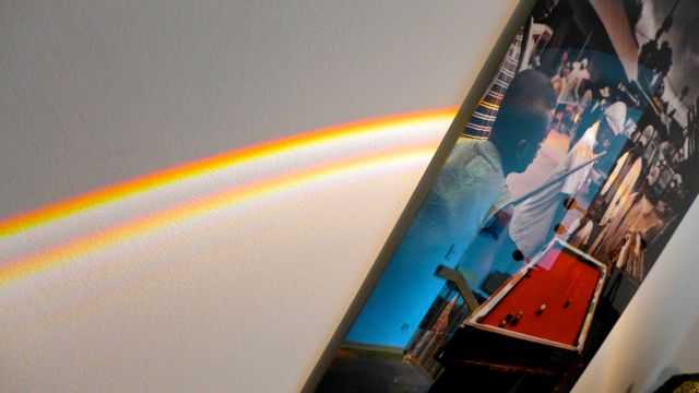 Rainbow across wall of Impact Solutions office