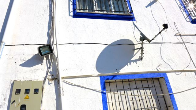 Satellite dish and shadow in the town