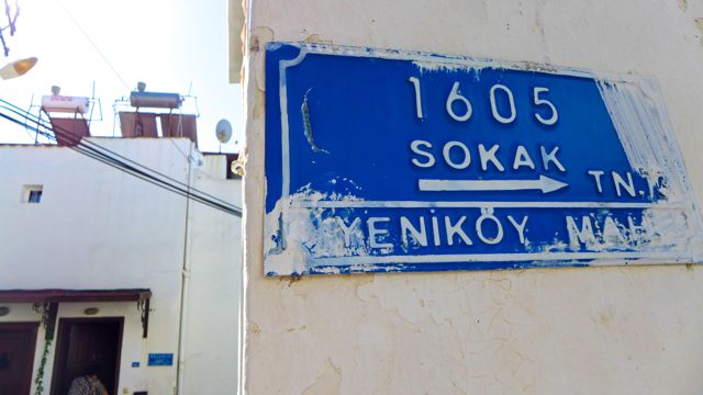 Street sign, showing signs of vigorous whitewashing