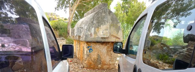 Tomb sandwiched between cars on way back to boat