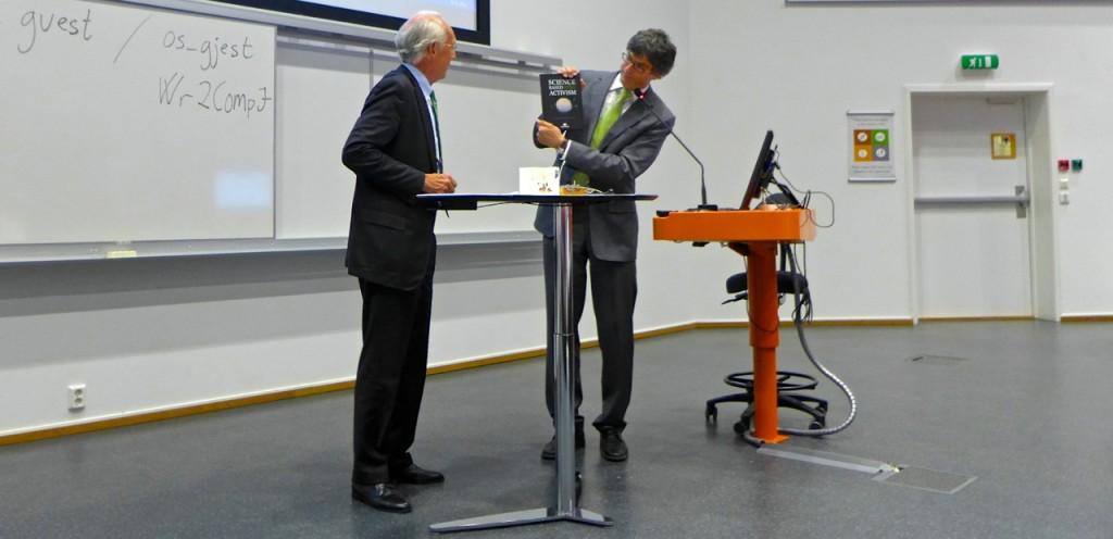 Per Espen presents Jørgen with the book, originally designed as a surprise
